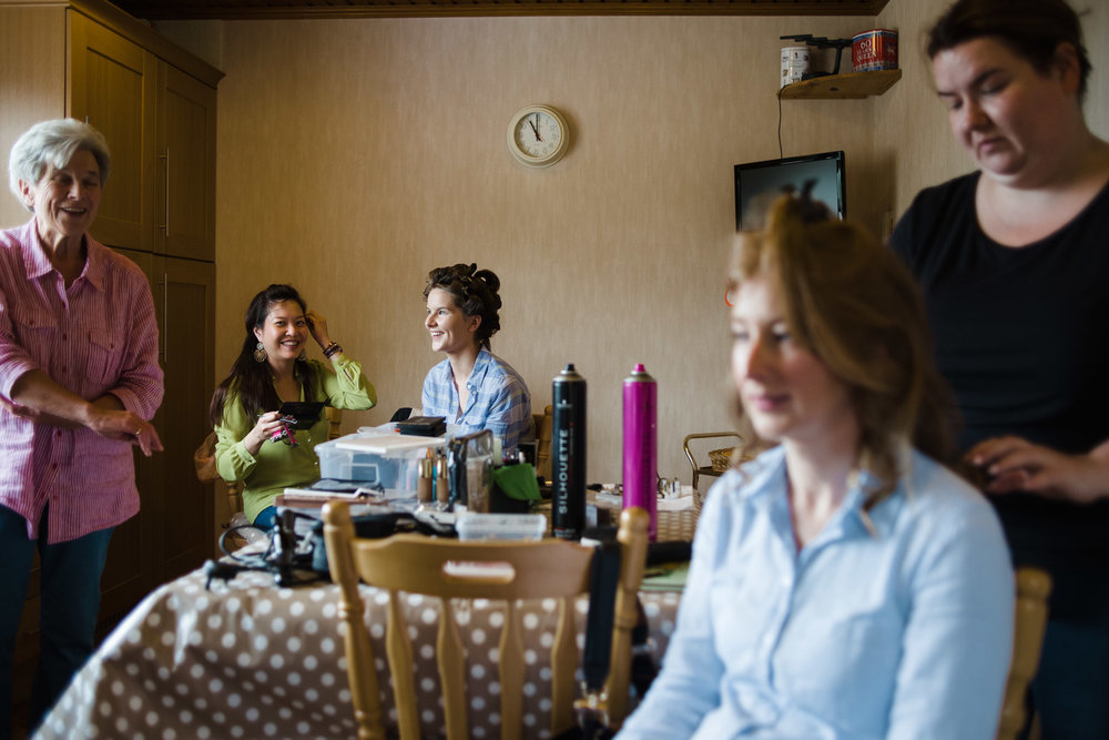 Bride and bridesmaids get their hair and makeup on the morning of wedding