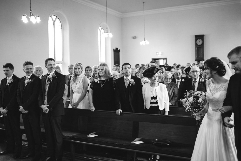 Bride and groom see each other for the first time at their wedding, Randalstown Presbyterian Church, Northern Ireland