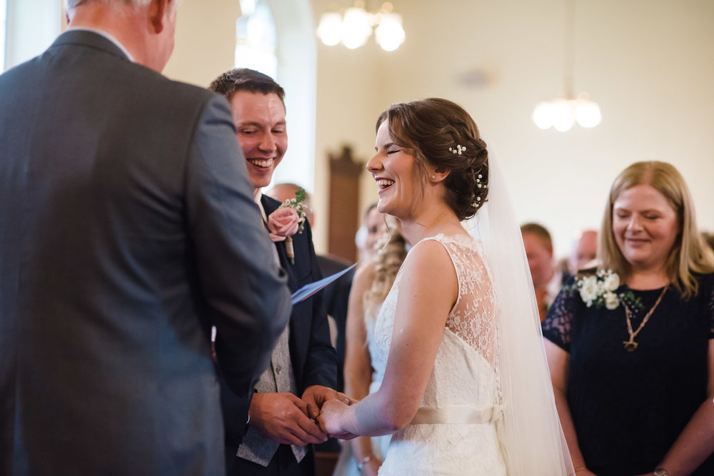Bride and Groom laughing during wedding ceremony,Randalstown Presbyterian Church, Northern Ireland