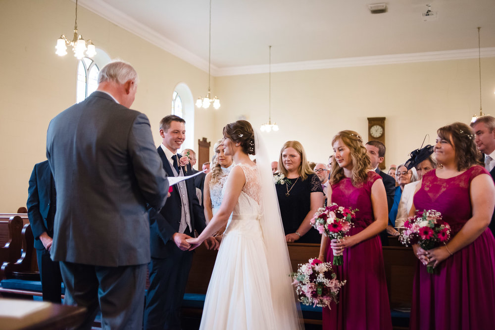Bride and Groom during wedding ceremony,Randalstown Presbyterian Church, Northern Ireland