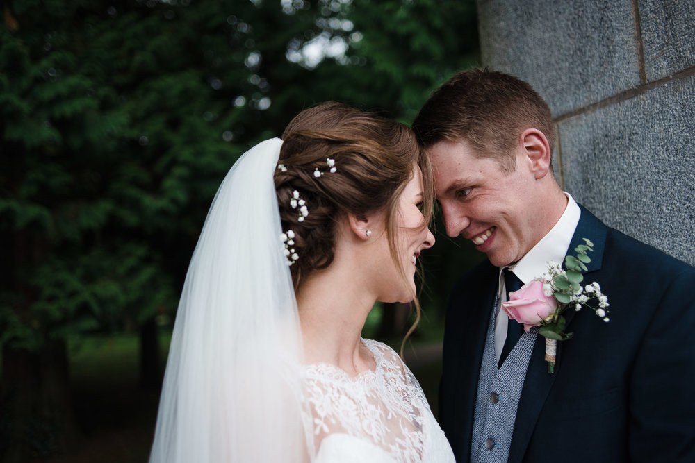 Bride and Groom look and smile at each other, Antrim Castle Gardens, Northern Ireland