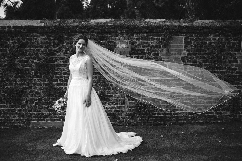 Bride lets veil blow in the breeze, Antrim Castle Gardens, Northern Ireland