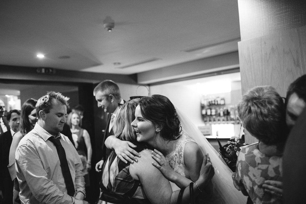 Bride greets guests before reception, Ross Park Hotel, Kells, Ballymena