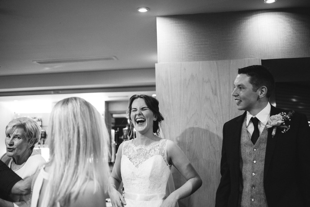 Bride Laughs while greeting guests, Ross Park Hotel, Kells, Ballymena