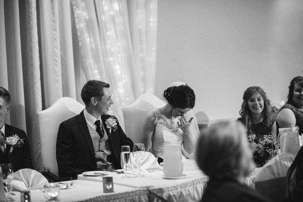 Bride & Groom laugh at speech, Ross Park Hotel, Kells, Ballymena