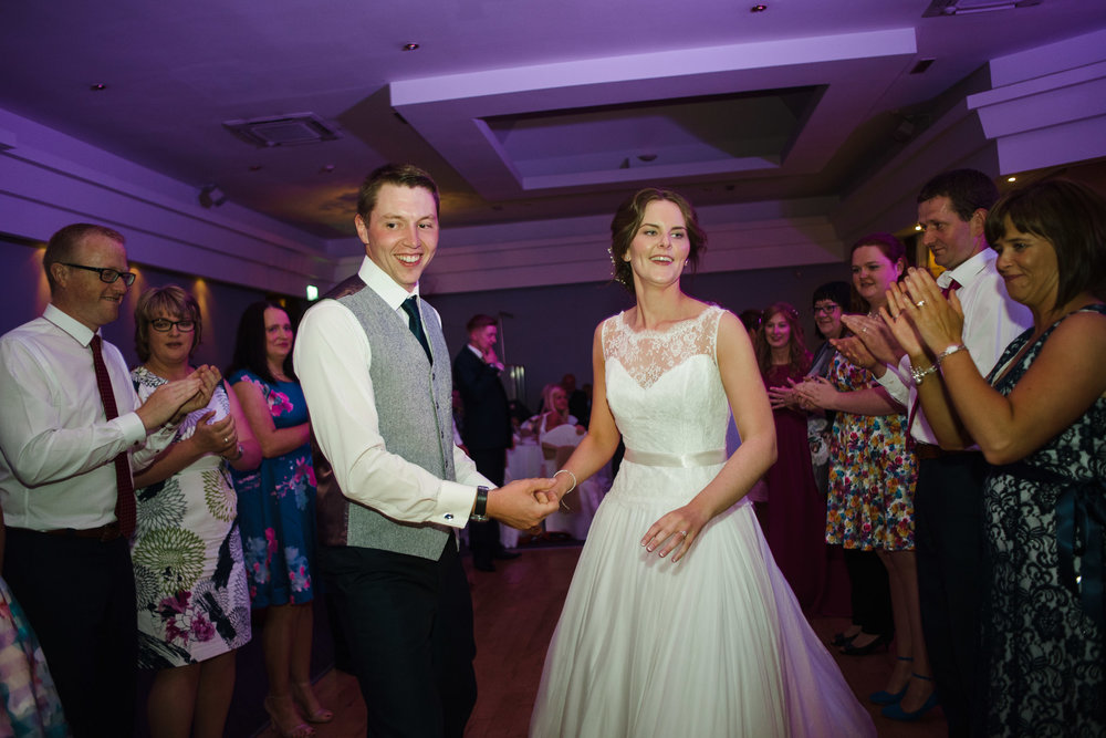 Bride and groom dance and play game at wedding party, Ross Park Hotel, Kells, Ballymena