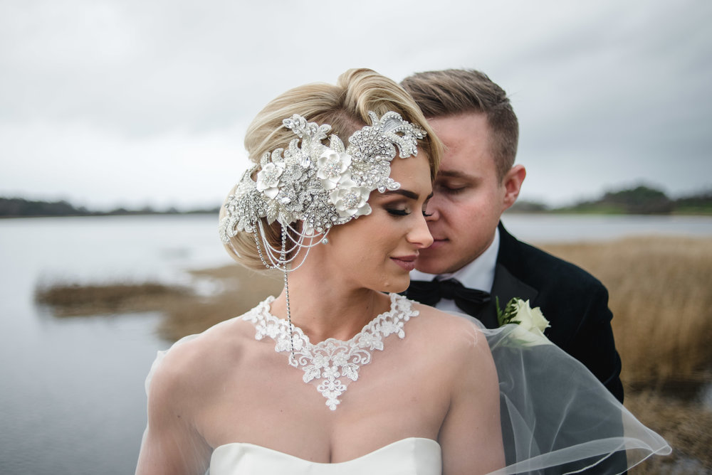 Bride and Groom, Sarah and Alan, share an intimate moment, on the bridge at the Lough Erne Resort in County Fermanagh, Northern Ireland, after their wedding - Wedding Photography by Photographer Connor McCullough
