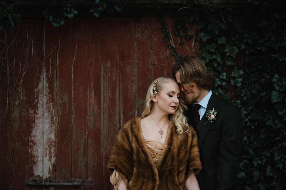 Bride & Groom In Front Of Red Barn Door At The Mill At Ballydugan Downpatrick County Down Northern Ireland Wedding Photography by Photographer Connor McCullough