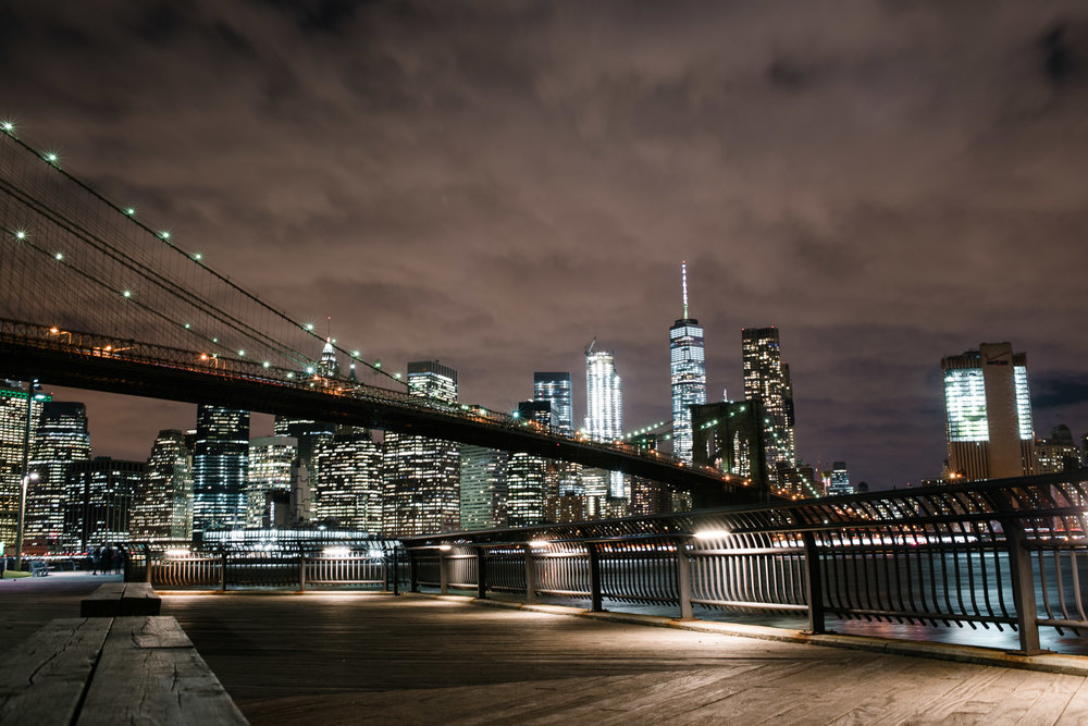 Lower Manhattan Skyline behind the Brooklyn Bridge at night, NYC