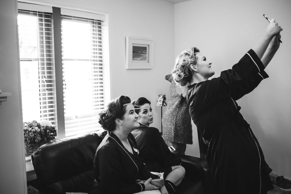 Bridal Party bridesmaids take selfie while getting ready, Lough Erne Resort, County Fermanagh, , Northern Ireland, New Years Eve, Great Gatsby, 1920's, 1920, 1920s, themed wedding