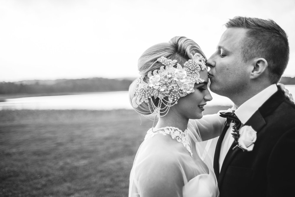 Groom gives bride a kiss on the forehead,Lough Erne Resort, County Fermanagh,, Northern Ireland, New Years Eve, Great Gatsby, 1920's, 1920, 1920s, themed wedding