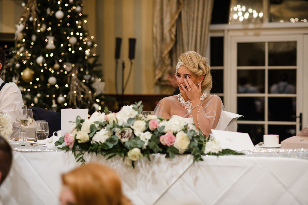 Bride laughs as Mindreader David Meade entertains wedding guests after dinner,Lough Erne Resort, County Fermanagh, Northern Ireland, New Years Eve, Great Gatsby, 1920's, 1920, 1920s, themed wedding
