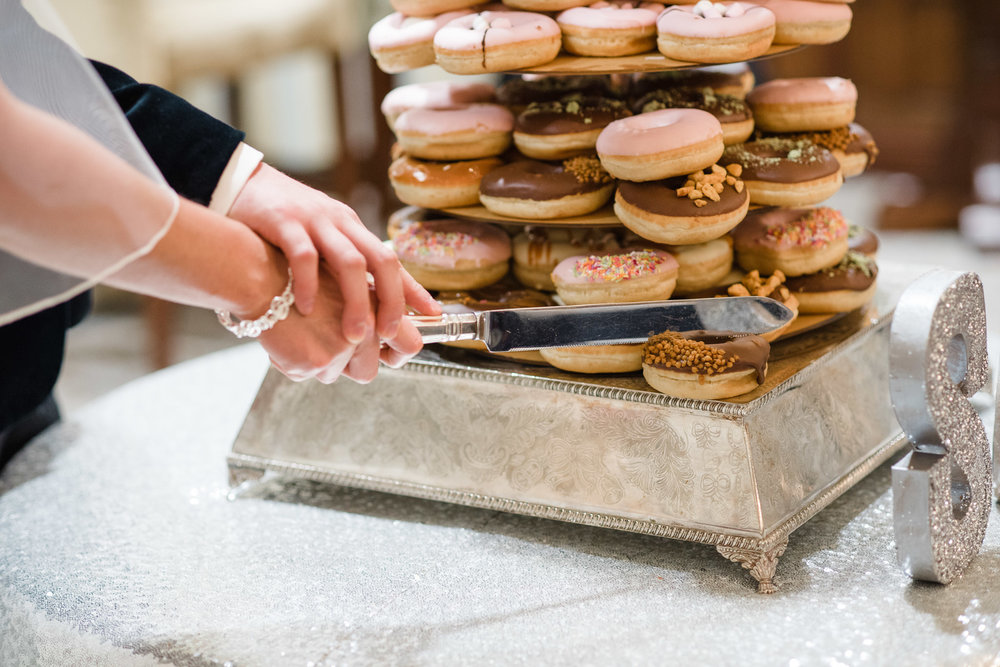 Bride and groom cut into donut, doughnut, wedding cake by Doughzy Donuts,Lough Erne Resort, County Fermanagh, Northern Ireland, New Years Eve, Great Gatsby, 1920's, 1920, 1920s, themed wedding