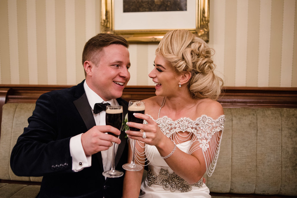 Bride and Groom drink Guinness from champagne flutes, Lough Erne Resort, County Fermanagh, , Northern Ireland, New Years Eve, Great Gatsby, 1920's, 1920, 1920s, themed wedding