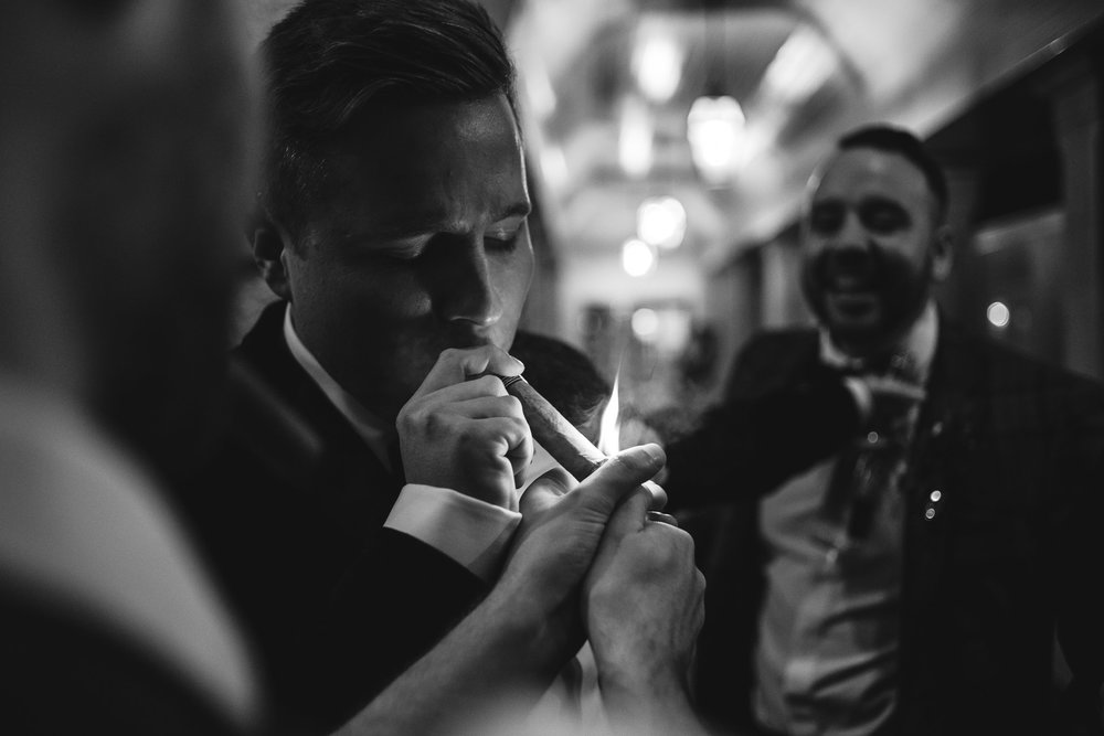 Groom lights cuban cigar, Lough Erne Resort, County Fermanagh, Northern Ireland, New Years Eve, Great Gatsby, 1920's, 1920, 1920s, themed wedding