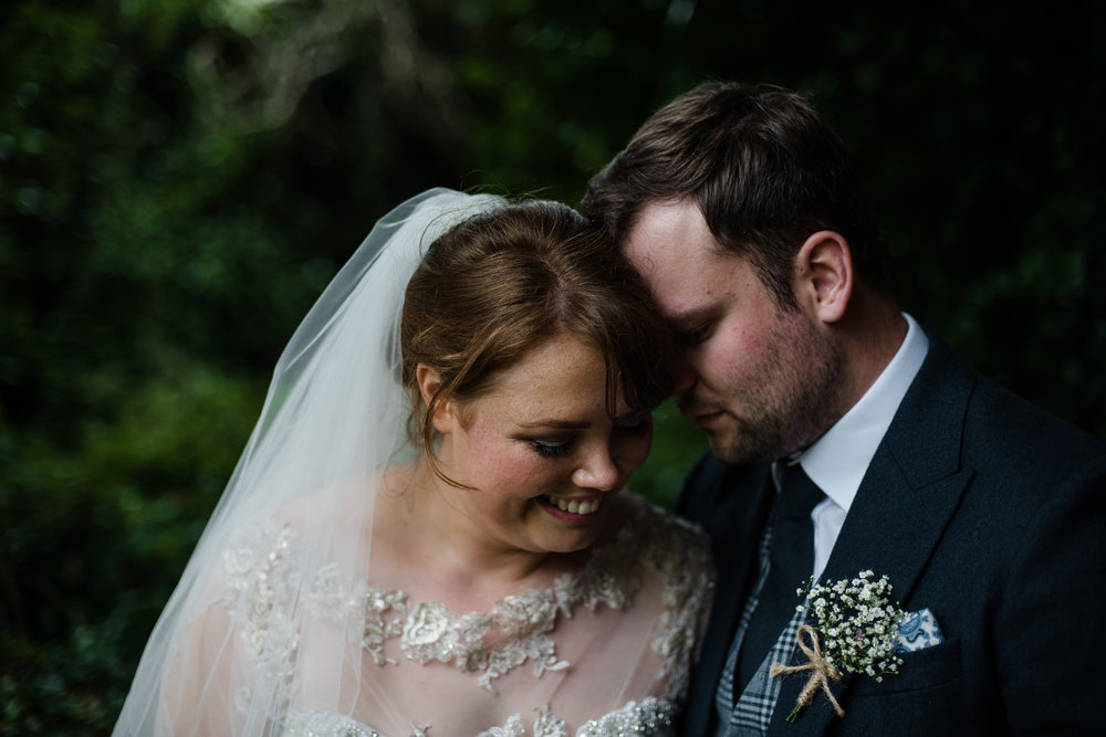 Bride and Groom smile together on their wedding day, at the Mill at Ballydugan, County Down, Northern Ireland