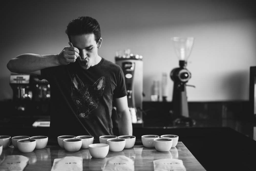 Coffee Sourcer and Quality Control expert Jan Komarek cups coffee in his lab at Bailies Coffee Roasters in Belfast