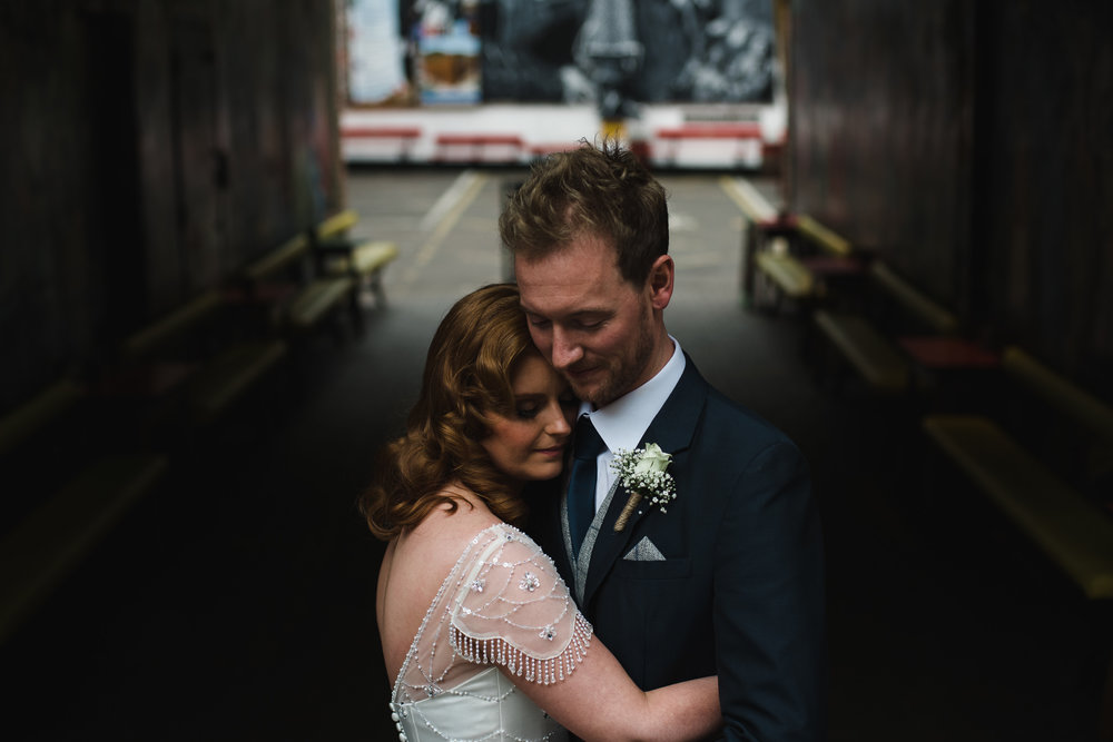 Bride and Groom cuddle in Belfast Cathedral Quarter, Wedding Photography by Photography Connor McCullough